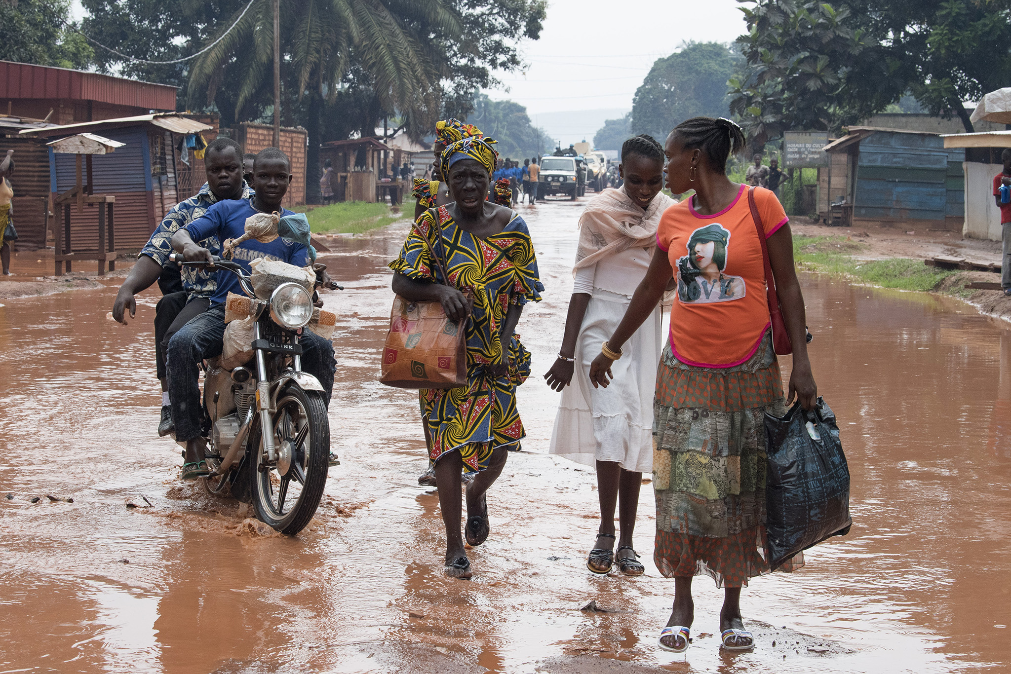 Residents walk down a street in the PK5 district in Bangui, Central African Republic