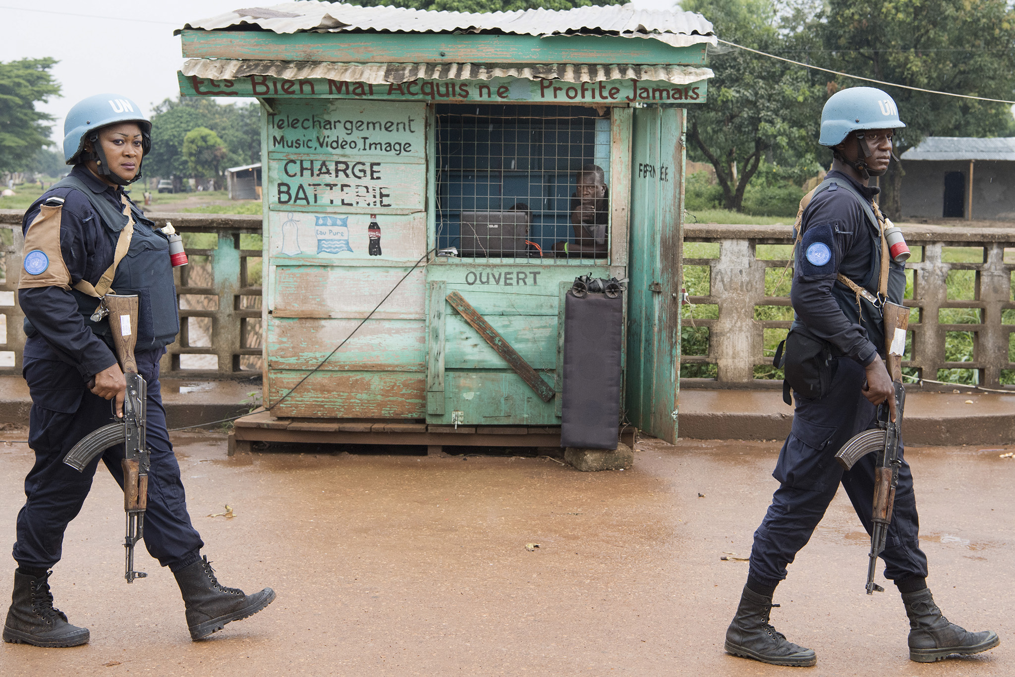 Armed UN Peacekeepers (one woman and one man) patrol the PK5 district in Bangui, Central African Republic