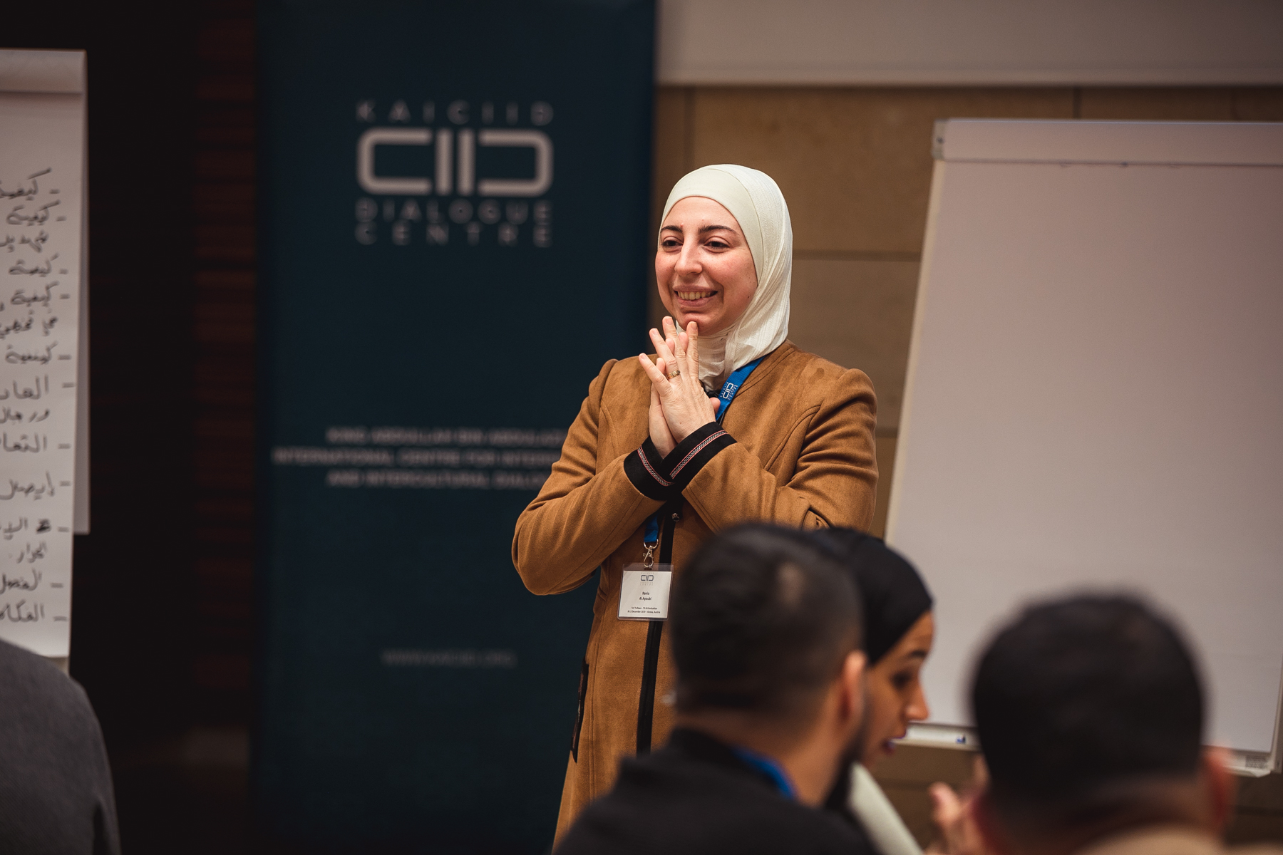 KAICIID Fellow Dr. Rania Alayoubi speaks at a KAICIID training
