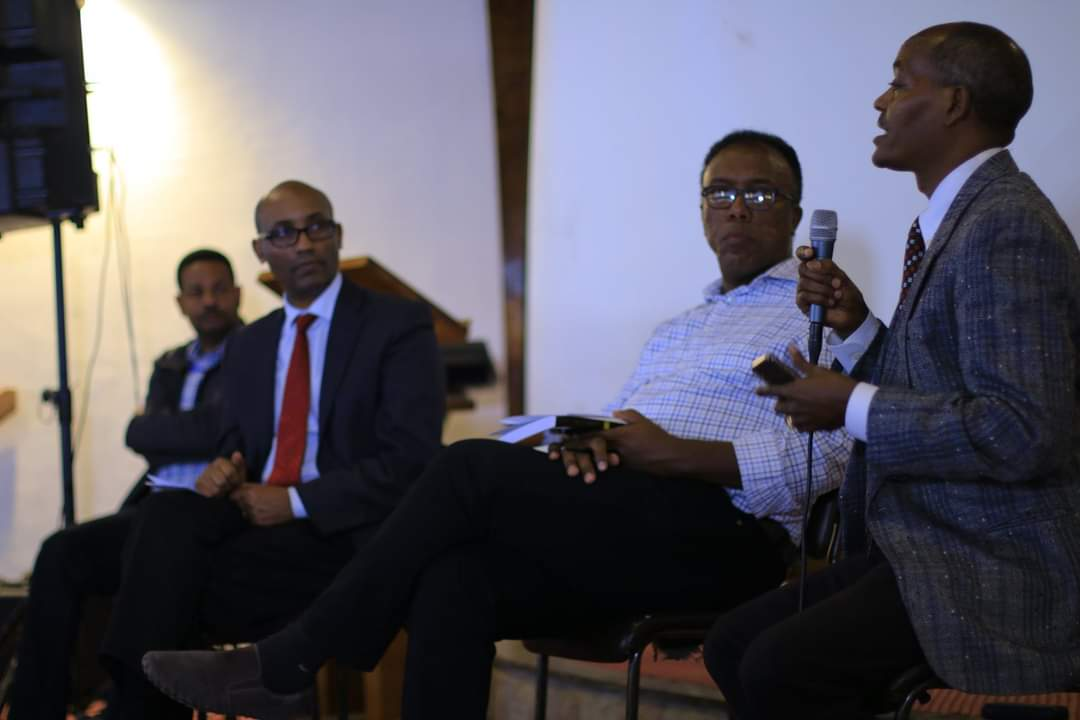 KAICIID Fellow Geleta Simesso sits with three other Ethiopian men