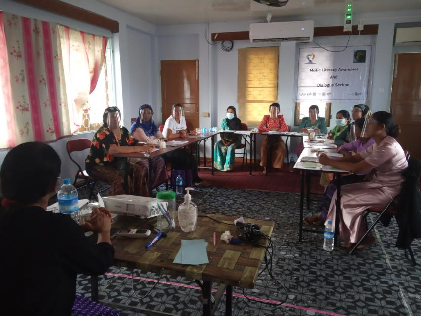 Women in a classroom discuss media literacy at a training in Myanmar sponsored by KAICIID