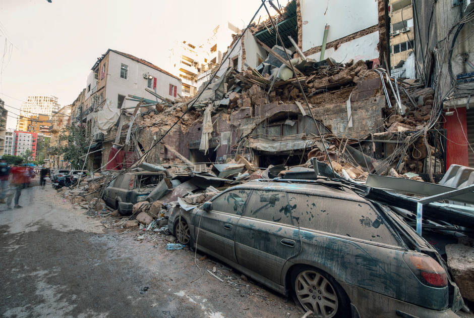 Debris from collapsed houses has fallen on a smashed car during the Beirut explosion