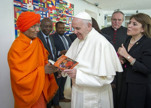 Board Member Swami Agnivesh presents a copy of his book to H.H Pope Francis. Photo: Swami Agnivesh