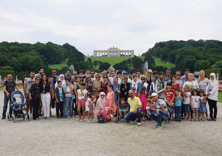 Programme participants stand before the Gloriette, a Viennese landmark located at the Schönbrunn palace in Vienna, Austria.