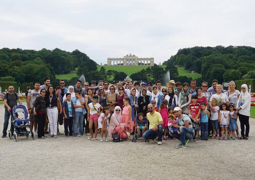 Programme participants stand before the Gloriette, a Viennese landmark located at the Schönbrunn palace in Vienna, Austria.