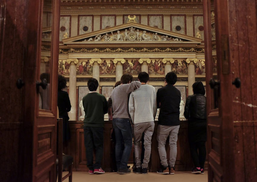 Young asylum seekers look on during the tour of the Austrian parliament.
