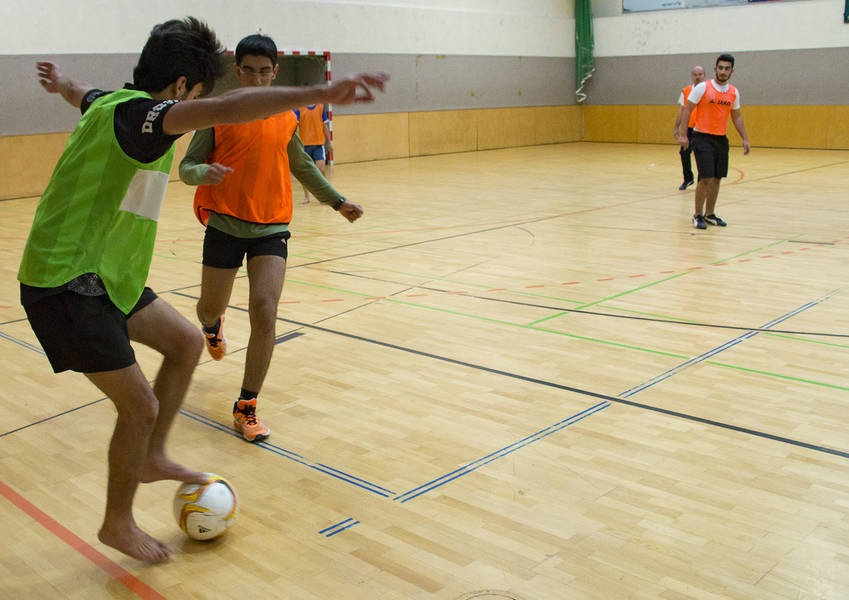 Asylum seekers play football at a gymnasium in Vienna.