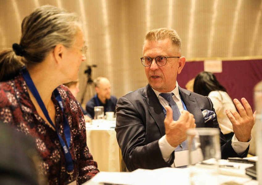 Ambassador Teresa Indjein from Austria speaking with Ambassador Pekka Metso from Finland