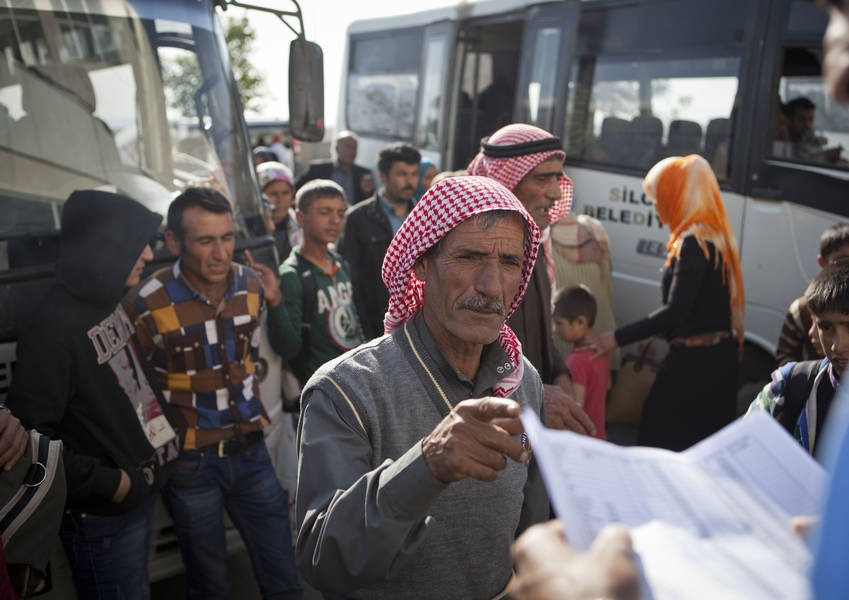 Kurdish Refugees from Kobane, Syria, at the bus station in Silope, Turkey, waiting for the transportation to the Gawilan camp in northern Iraq.