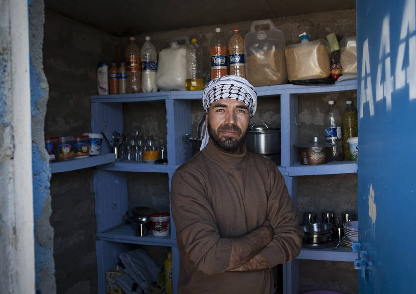 Syrian Sunni refugee in a shop in the Gawilan Camp, Northern Iraq.