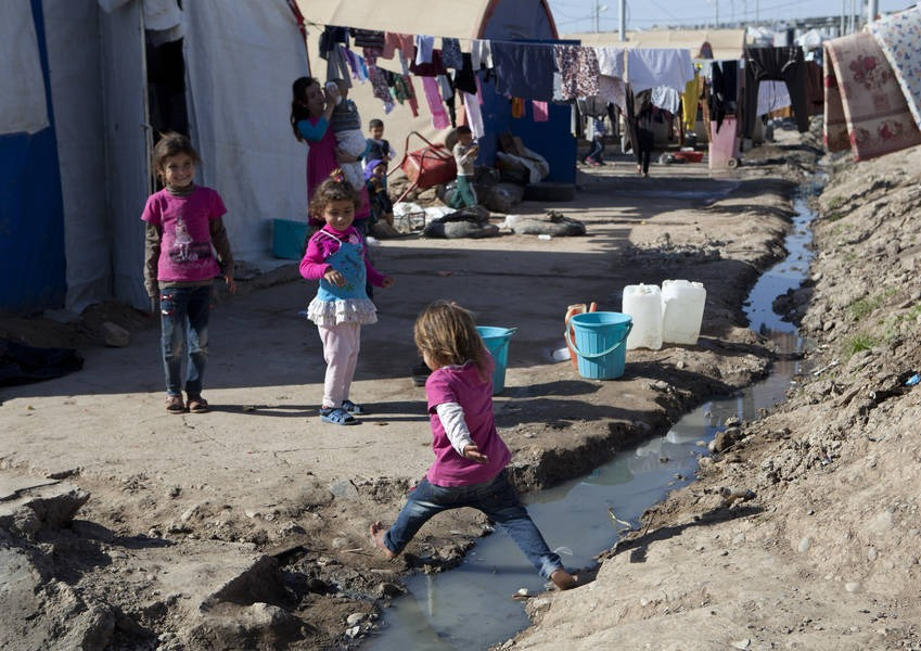 Children at the Bajed Kandala camp close to the Syrian border, a dusty, ill-equipped camp in northern Iraq. Yazidis fleeing a jihadist offensive say members of their families - men, women and even babies - have been abducted by militants.