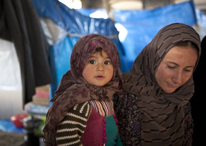 Shabak mother with child in a mosque in Bardarash, Northern Iraq.