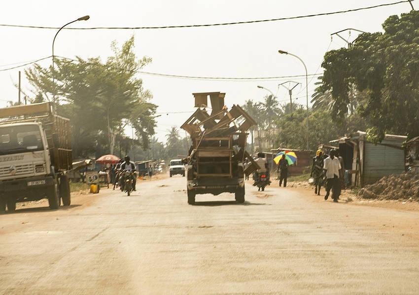An overloaded truck hauls furniture down a central street in Bangui. Photo: Kaleb Warnock/KAICIID