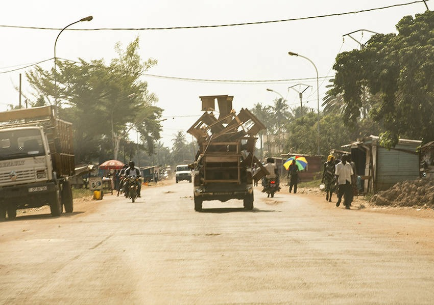 An overloaded truck hauls furniture down a central street in Bangui. Photo: Kaleb Warnock/KAICIID