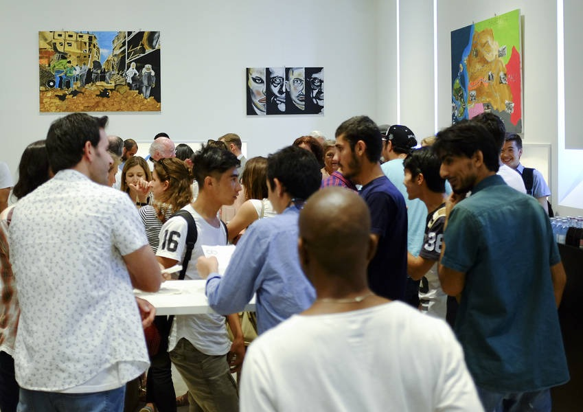 The exhibition 'Growing 'Together was hosted in the KAICIID Exhibition Room.