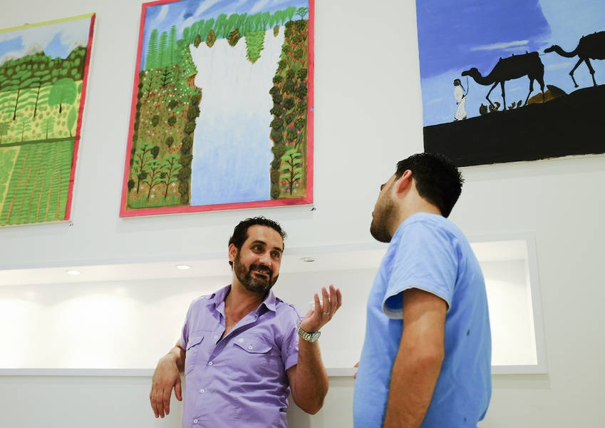 The paintings inspired discussion among participants.