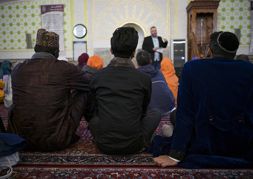 The Fellows look on as they receive a presentation from the Centre's Imam on the tenants and structure of religious worship in a mosque.
