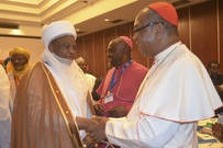 The Archbishop of Abuja, Cardinal John Onaiyekan welcomes the Sultan of Sokoto, Alhaji Saad Abubakar III.